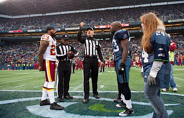 After a near melee between co-captains, order was restored and referee Clete Blakeman only allowed one captain per team to attend when he finally was able to toss the coin.