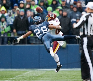 Safety Earl Thomas makes a diving pass deflection on a ball intended for Washington's Santana Moss.