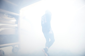 Seahawks safety Kam Chancellor heads into the smoke and fog of the pregame introductions.