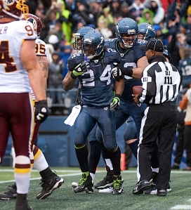 Marshawn LYnch celebrates his 20-yard touchdown pass and run from Tarvaris Jackson.