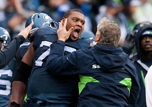 Bryant was still fired up when met by coach Pete Carroll on the sidelines after the blocked field goal.
