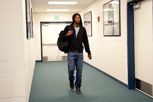 Hours before kickoff, receiver Sidney Rice enters the team's locker room at CenturyLink Field.