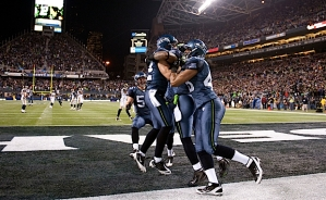 Members of the Seahawks special teams celebrate in the end zone after they blocked a punt for a touchdown.
