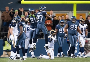 Safeties Earl Thomas and Atari Bigby celebrate after forcing St. Louis quarterback Sam Bradford into an intentional grounding penalty in the red zone.