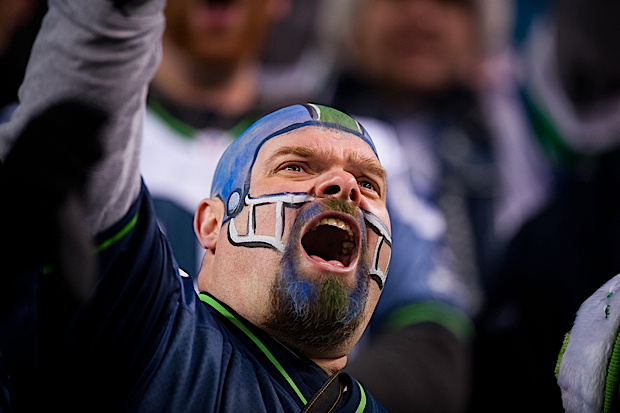 This member of the 12thMAN didn't feel the need for a hat in the winter cold, he just painted a helmet on his bald head instead.