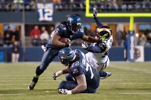 "Seattle's running game features Marshawn Lynch, who went ""Beast Mode"" with this stiff arm in the second half."