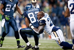 St. Louis safety Darian Stewart lost his helmet in an effort to bring down Seattle receiver Ben Obomanu.