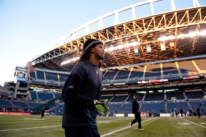 Safety Earl Thomas warms up on the field as the last of the December sun fell on CenturyLink Field.