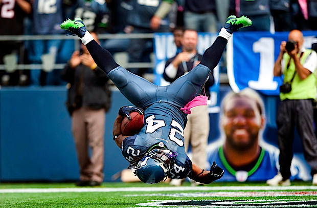 "Marshawn Lynch decided to ""flip"" himself into the end zone at the end of an 11-yard touchdown run against the Atlanta Falcons at CenturyLink Field."