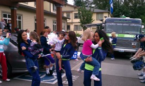 Children of the Seattle Ronald McDonald House interact with members of the Sea Gals, while the Seahawks Blue Thunder drumline performs.