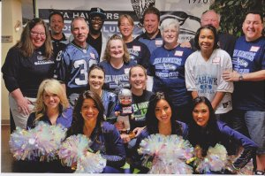 The Sea Hawkers crew with members of the Sea Gals and Seahawks cornerback Walter Thurmond.