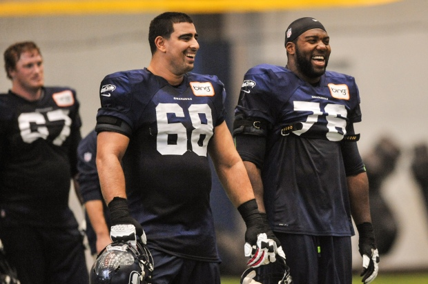 Breno Giacomini, Russell Okung, Paul McQuistan