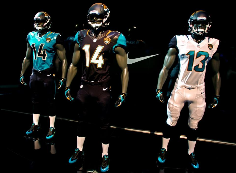 The Jacksonville Jaguars rolled out their new-look Nike uniforms today,  joining the Seahawks as the second NFL team to give their jerseys a total  makeover ...
